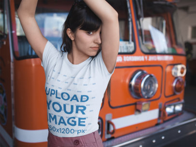 T-Shirt Mockup of a Girl Posing in Front of a Fire Truck 19617