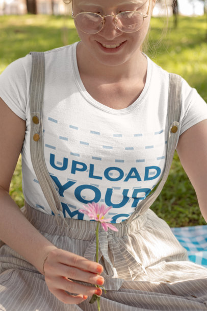 Mockup of a Smiling Woman Holding a Flower in a Park 22000