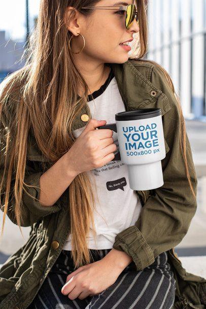 Mockup of a Girl Holding a Travel Mug Outside an Office 24341