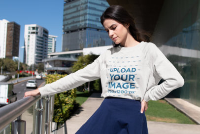 Crewneck Sweatshirt Mockup of a Girl Outside a Modern Building 18253