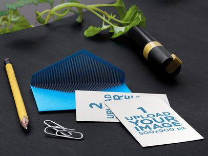 Mockup of an Open Envelope Lying Next to Some Office Supplies a6517