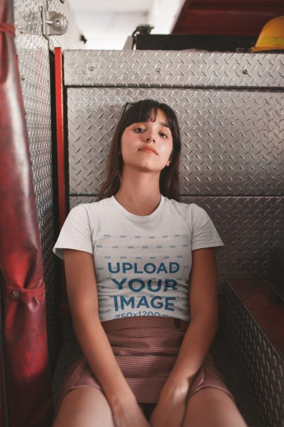Tshirt Mockup of a Girl Sitting on Top of a Fire Truck 19623