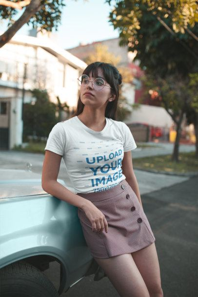 Mockup of a Girl with Round Glasses Wearing a Tshirt on the Street 19632