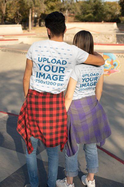 Back T-Shirt Mockup of a Couple Taking a Walk at a Skatepark 25236
