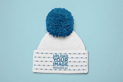 Mockup of a Pom Pom Beanie Lying Flat on a Surface 24588