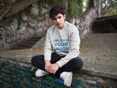 Mockup of a Serious Man Wearing a Heathered Sweater at a Park 18198