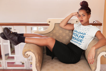 T-Shirt Mockup of a Woman with Braids Sitting on an Armchair 24081