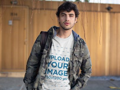 T-Shirt Mockup of Young Man in a Camo Jacket 18190