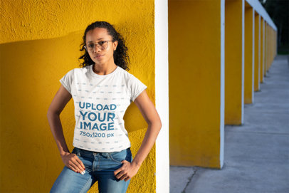 Mockup of a Woman Wearing a T-Shirt with Her Hands on Her Hips 24105