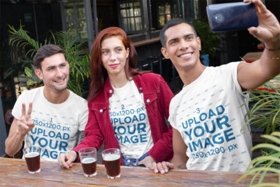 T-Shirt Mockup of Three Friends Taking a Selfie at a Bar 25254