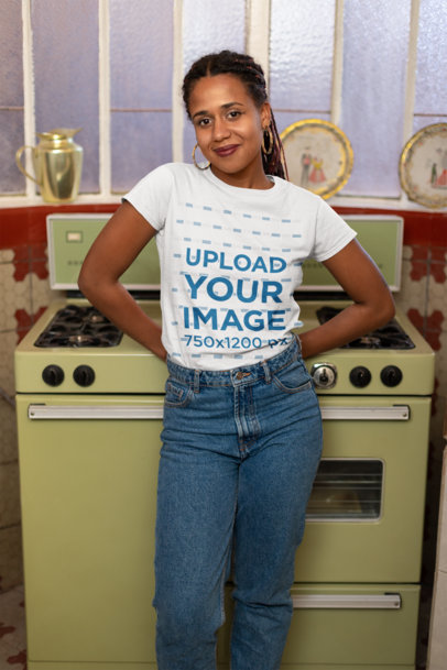 Tee Mockup of a Girl with Locks Posing in Front of a Vintage Kitchen 24092