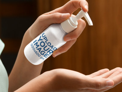 Label Mockup Featuring a Woman Applying Moisturizing Cream on her Hands a7154