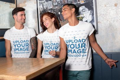 T-Shirt Mockup of Three Friends at a Bar 25255