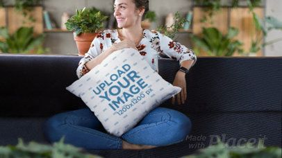 Parallax Video of a Happy Woman Holding a Square Throw Pillow 26019