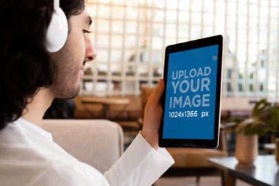 iPad Mockup of a Man Listening to a Podcast with Headphones 24803
