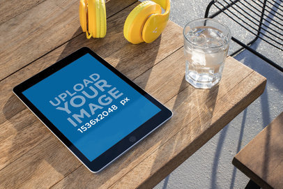 Podcast Mockup of an iPad Lying on a Wooden Table 24722