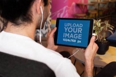 Landscape iPad Mockup of a Man Listening to a Podcast 24804