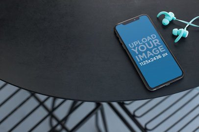 Mockup for a Podcast Featuring an iPhone XS Max Next to a Pair of Blue Earphones 24721