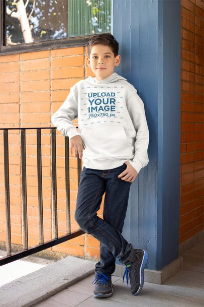 Hoodie Mockup of a Kid Leaning on a Fence 24839