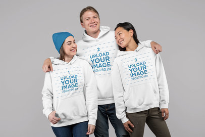 Studio Mockup Featuring Three People Wearing Hoodies 25717