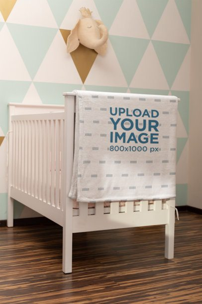 Blanket Mockup Featuring a Baby Crib in a Nursery 24694