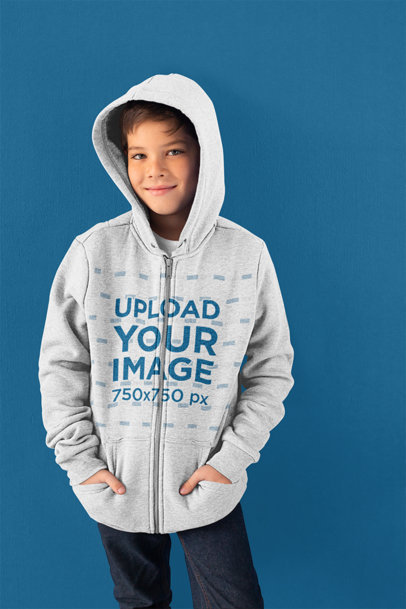 Hoodie Mockup of a Young Boy Posing in Front of a Colored Wall 24848