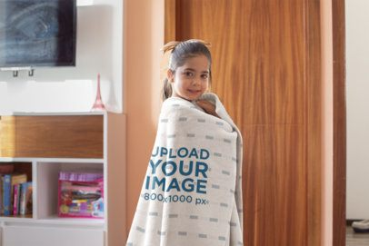 Mockup of a Little Girl Wrapped in a Throw Blanket 24693