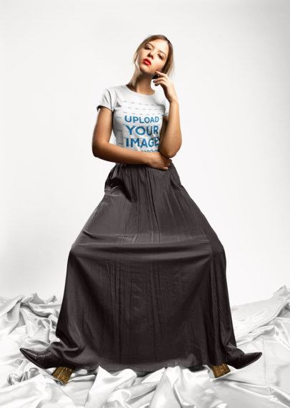 T-Shirt Mockup Featuring a Girl Wearing a Long Skirt in a Colored Background 18492