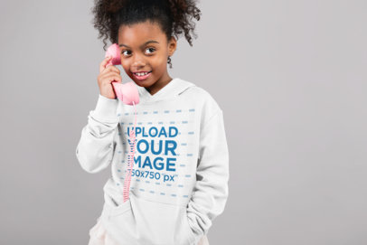 Hoodie Mockup of a Girl Playing with a Wire Phone 24865