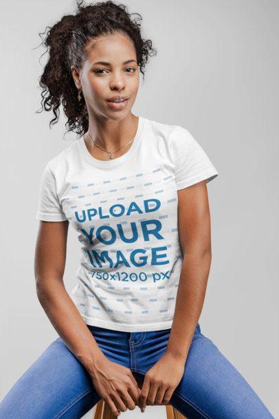 T-Shirt Mockup of a Woman Sitting on a Stool 21894
