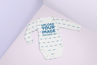 Baby Onesie Mockup Lying in a Multicolored Surface 25167