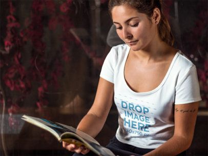 T-Shirt Mockup Featuring a Woman Reading a Magazine 6460a