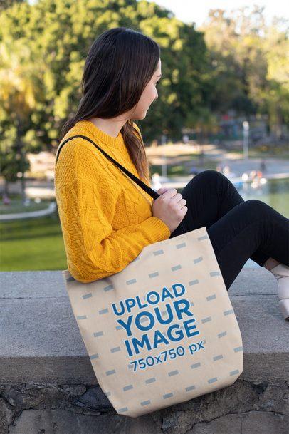 Tote Bag Mockup of a Girl Sitting at a Park 24883