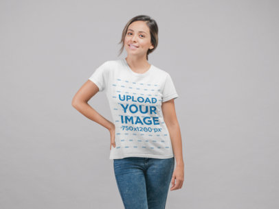Simple T-Shirt Mockup of a Young Woman Standing in a Studio 22336
