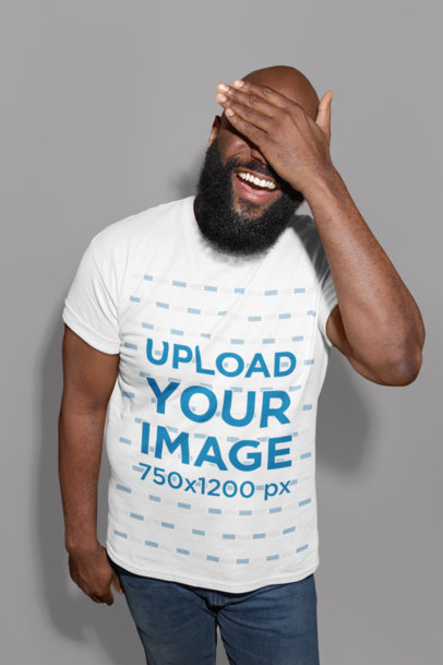 T-Shirt Mockup of a Man with Beard Laughing While Covering His Face 21533
