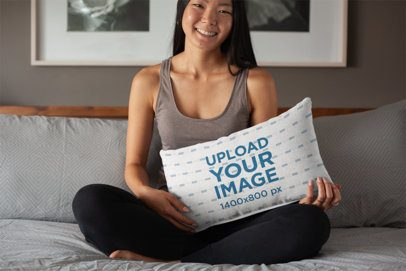 Pillow Mockup Featuring a Woman Sitting Cross-Legged on Her Bed 25898