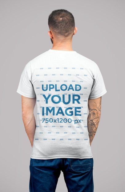 Back View Mockup of a Tattooed Man Wearing a Round Neck Tee at a Studio 22342