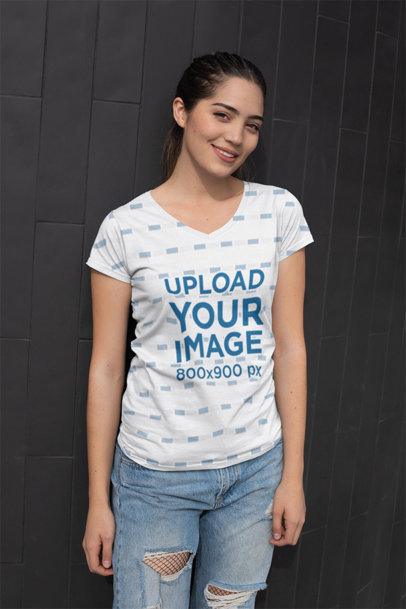 T-Shirt Mockup Featuring a Coy Girl Standing in Front of Wall Tiles 24936