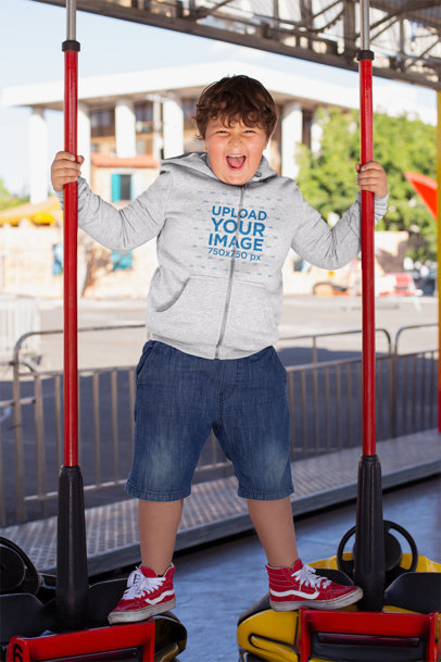 Plus Size Hoodie Mockup of a Kid Having Fun on the Bumper Cars 25550