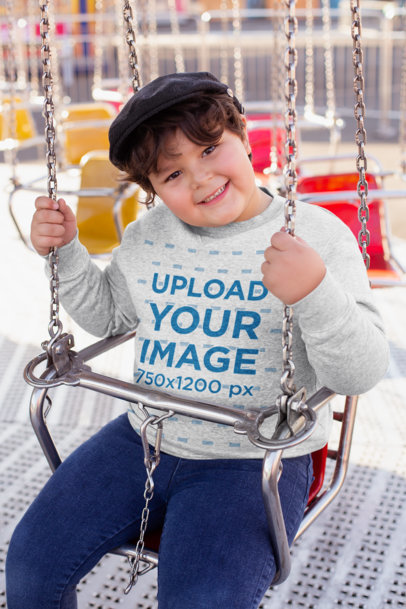 Plus Size Sweatshirt Mockup of a Joyful Kid on a Swing Ride 25557