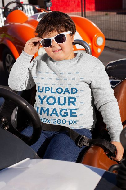 Plus Size Crewneck Sweater Mockup of a Kid Sitting in a Bumper Car 25559