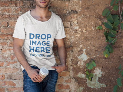 T-Shirt Mockup of a Man Leaning Against a Brick Wall 6511a