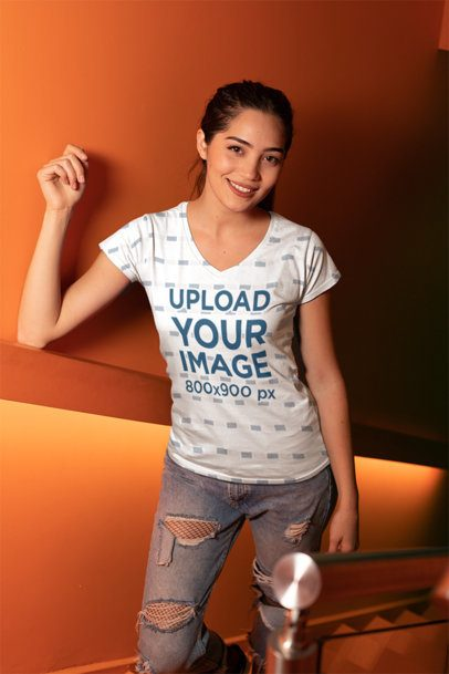 V-Neck T-Shirt Mockup of a Woman Leaning over a Wall 24908