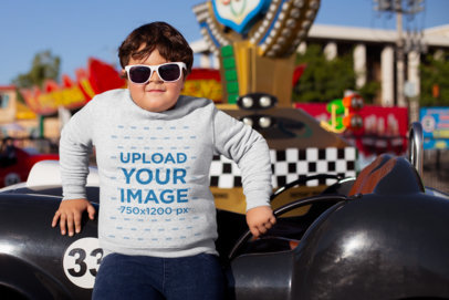 Plus Size Sweatshirt Mockup of a Kid with Sunglasses at a Theme Park 25560