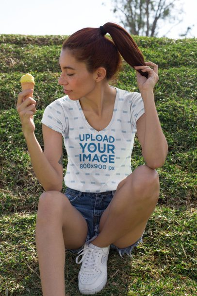 Sublimated V-Neck Tee Mockup of a Girl with Red Hair Holding an Ice Cream Cone 24985