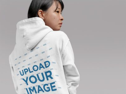 Back Pullover Hoodie Mockup of a Woman Looking over Her Shoulder at a Studio 21790
