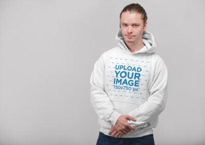Pullover Hoodie Mockup of a Blonde Man with Tied Hair Holding His Arm 23086