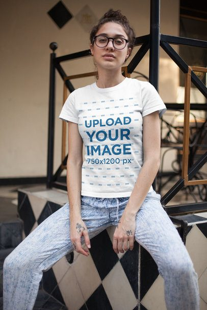 T-Shirt Mockup of an Alternative Girl Sitting in a Vintage Room 25800