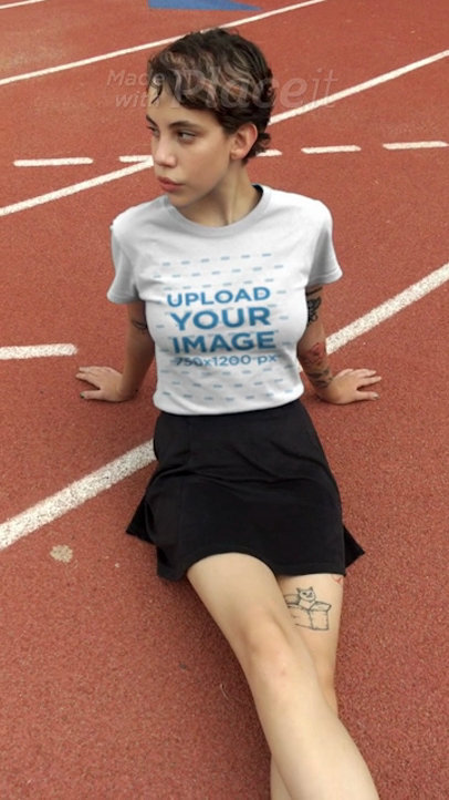 T-Shirt Video Maker Featuring a Gorgeous Girl Sitting on a Track Field 23269