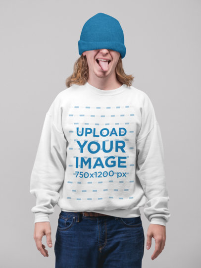 Sweatshirt Mockup of a Man Covering His Eyes with a Beanie and Showing His Tongue 23095